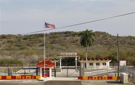 The Northeast gate marks the end of U.S. soil as the road leads into Cuba at Guantanamo Bay U.S. Naval Base, March 8, 2013. Picture taken March 8, 2013. REUTERS/Bob Strong