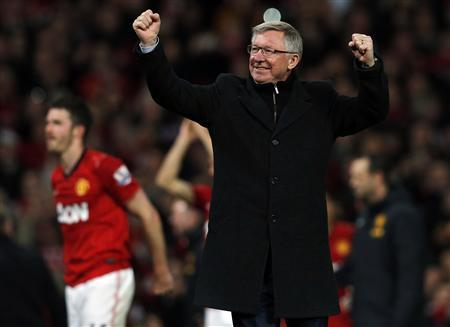 Manchester United's manager Alex Ferguson celebrates after his team clinched the English Premier League soccer title with a win against Aston Villa at Old Trafford in Manchester, northern England, April 22, 2013. Manchester United won their 20th league title on Monday when a Robin van Persie hat-trick led them to 3-0 victory over Aston Villa and gave them an unassailable 16-point lead over last season's Premier League champions Manchester City. REUTERS/Phil Noble