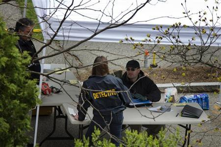 Members of the FBI Evidence Recovery Team work around the home where Boston Marathon bombing suspect Dzhokhar Tsarnaev was hiding at 67 Franklin St. in Watertown, Massachusetts, April 20, 2013. REUTERS/Lucas Jackson