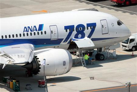 An All Nippon Airways' (ANA) Boeing Co's 787 Dreamliner plane receives restoration work at Okayama airport in Okayama, western Japan, in this photo taken by Kyodo April 22, 2013. REUTERS/Kyodo