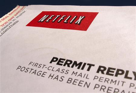 A Netflix return CD mail envelope is shown in Encinitas, California, April 19,2013. Netflix Inc reported on April 22, 2013 a first-quarter profit that beat Wall Street expectations as the dominant video rental service added new streaming subscribers in the United States. Netflix shares soared to $207.39 in after-hours trading, rising 19 percent from a close of $174.37 on Nasdaq. For January through March, Netflix recorded $19 million in net income, excluding a loss for retiring debt, and adjusted earnings per share of 31 cents. Picture taken April 19, 2013. REUTERS/Mike Blake