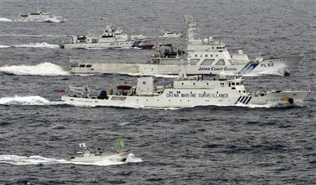 An aerial photo shows a Chinese marine surveillance ship Haijian No. 66 (C) cruising next to Japan Coast Guard patrol ships in the East China Sea, near known as Senkaku isles in Japan and Diaoyu islands in China, in this photo taken by Kyodo April 23, 2013. REUTERS/Kyodo