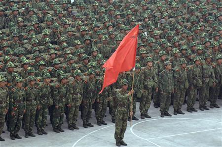 Chinese soldiers prepare to start a march drill on the outskirts of Hefei, east China's Anhui province October 15, 2007. REUTERS/Jianan Yu
