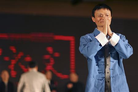 Jack Ma (R), the chairman of China's largest e-commerce firm Alibaba Group, gestures before giving a performance of Tai Chi at the Annual Summit of Green Companies 2013, in Kunming, Yunnan province April 21, 2013. REUTERS/Wong Campion
