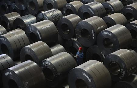 An employee works inside a steel export factory in Taiyuan, Shanxi province, April 10, 2013. REUTERS/Jon Woo