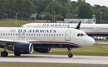 A US Airways jet prepares to take off in Charlotte, North Carolina April 20, 2012. REUTERS/Chris Keane