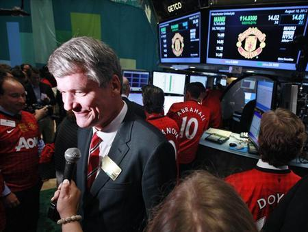 Manchester United CEO David Gill gives an interview following Manchester United Ltd initial public offering on the floor of the New York Stock Exchange, August 10, 2012. REUTERS/Brendan McDermid