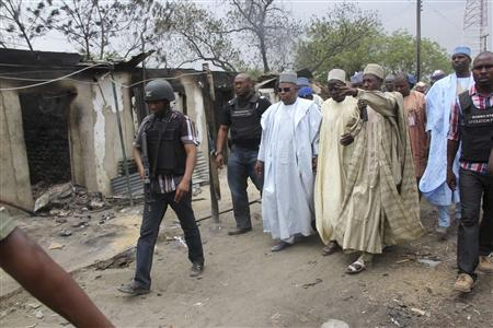 Borno State Governor Kashim Shettima (3rd L) visits Baga on an assessment tour of the town following heavy fighting, in this April 20, 2013 handout photo. REUTERS/Handout