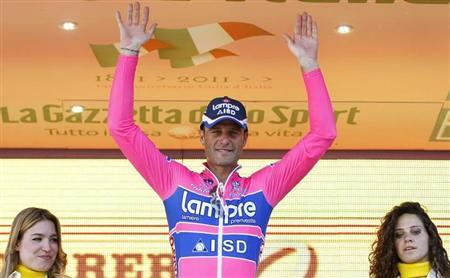 Alessandro Petacchi of Italy celebrates on the podium after winning the 244km second stage of the Giro d'Italia cycling race from Alba to Parma May 8, 2011. REUTERS/Alessandro Garofalo