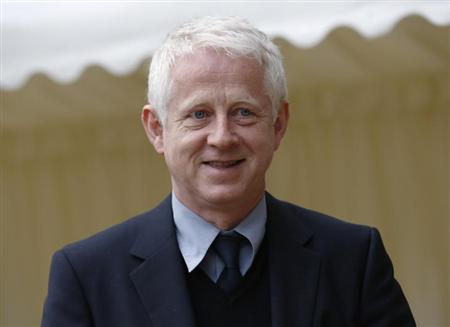 Director Richard Curtis arrives for a reception for the British Film Industry held by Britain's Queen Elizabeth and Prince Philip at Windsor Castle, southern England April 4, 2013. REUTERS/Luke MacGregor