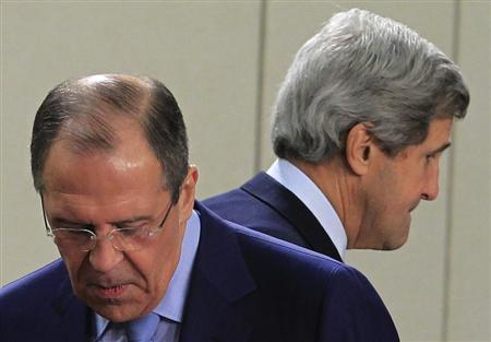 U.S. Secretary of State John Kerry (R) walks behind Russian Foreign Minister Sergei Lavrov (L) at the start of a NATO - Russia foreign ministers meeting at the Alliance's headquarters in Brussels April 23, 2013. REUTERS/Yves Herman