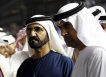 """Xeique governante de Dubai, Mohammed bin Rashid al-Maktoum, é visto durante campeonato mundial no Hipódromo Meydan, nos Emirados Árabes. Um treinador do haras Godolphin, que pertence ao xeique governante de Dubai, admitiu um """"erro catastrófico"""" na administração de estereoides para dopar cavalos no local. 30/03/2013 REUTERS/Ahmed Jadallah"""