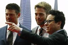 "Actors Karl Urban (L) and Chris Pine (C) look on as director J.J. Abrams points to a camera at the red carpet of the Australian premiere of ""Star Trek Into Darkness"" in central Sydney April 23, 2013. REUTERS/Daniel Munoz"