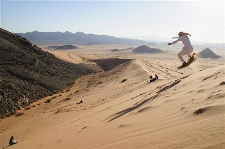 A man sand skis in the desert near Tabuk, 1,500 km (932 miles) from Riyadh December 27, 2012. REUTERS/Mohamed Alhwaity