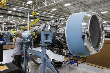 Cessna employee Lee York works on an engine of a Cessna business jet at the assembly line in their manufacturing plant in Wichita, Kansas March 12, 2013. REUTERS/Jeff Tuttle/Files