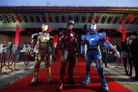 Performers dressed as Iron Man pose for a photo during a promotional event of the movie ''Iron Man 3'' before its release in China in early May at the Imperial Ancestral Temple of Beijing's Forbidden City, April 6, 2013. REUTERS/Jason Lee