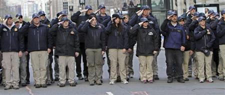 FBI officers stand near the site of the Boston Marathon finish line on Boylston Street during ceremonies symbolically releasing jurisdiction over to the city in Boston, Massachusetts, April 22, 2013. REUTERS/Chitose Suzuki/Boston Herald/Pool