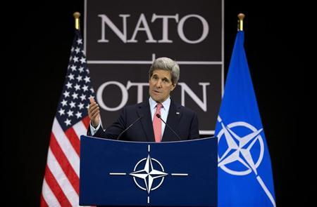 U.S. Secretary of State John Kerry gestures during a news conference at the NATO headquarters in Brussels April 23, 2013. REUTERS/Evan Vucci/Pool