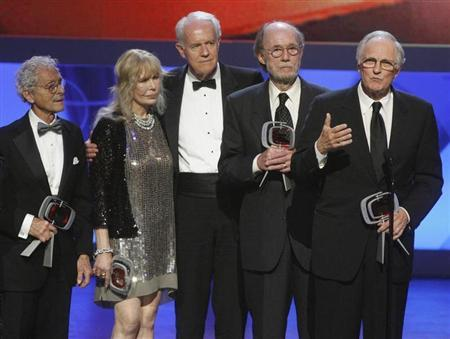Cast members of ''M*A*S*H*'' (L-R) Allan Arbus, Loretta Swit, Mike Farrell, Burt Metcalfe and Alan Alda accept the Impact award at the taping of the seventh annual TV Land Awards in Los Angeles, California April 19, 2009. REUTERS/Fred Prouser