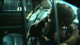 "Raed Jaser arrives to court in the back of a police car in Toronto, Ontario, April 23, 2013, in this still image taken from video courtesy of CTV News. Jaser of Toronto, 35, and Chiheb Esseghaier, 30, face charges that include conspiring ""with each other to murder unknown persons for the benefit of, at the direction of, or in association with a terrorist group."" REUTERS/CTV News/Handout"