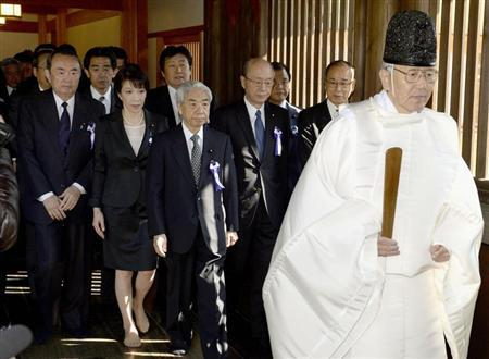 A group of lawmakers including Japan's ruling Liberal Democratic Party (LDP) lawmaker Hidehisa Otsuji (front 3rd L), Japan Restoration Party member Takeo Hiranuma (front L) and LDP member Sanae Takaichi (front 2nd L) are led by a shinto priest as they visit the Yasukuni Shrine in Tokyo, in this photo taken by Kyodo April 23, 2013. REUTERS/Kyodo