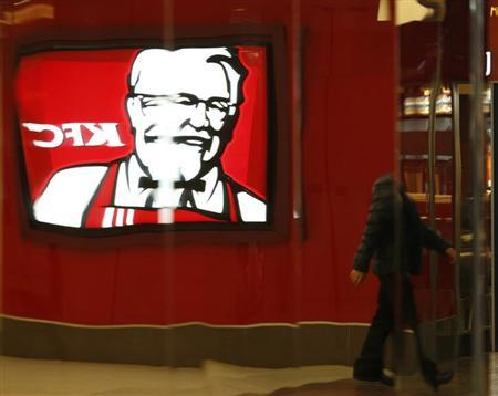 The logo of KFC restaurant is reflected on a metal wall at a shopping mall in Beijing, February 26, 2013. REUTERS/Kim Kyung-Hoon