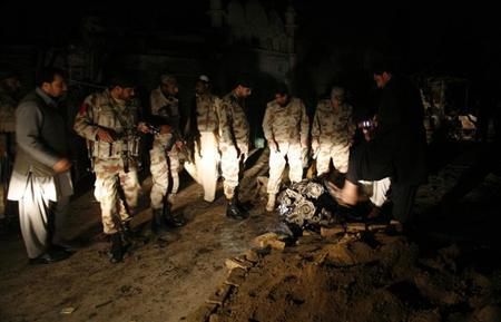 Pakistan Rangers examine the remains of a vehicle engine at the site of a bomb blast in Quetta April 23, 2013. REUTERS/Naseer Ahmed