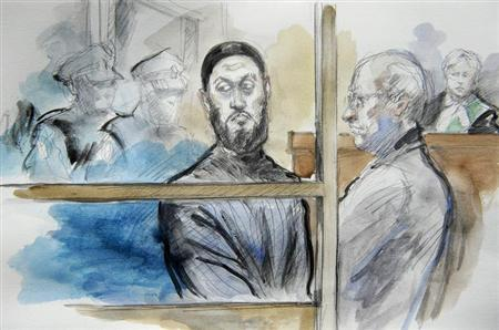 Raed Jaser (L) and lawyer John Norris are pictured in a courtroom sketch during a first appearance at Old City Hall Court in Toronto, Ontario April 23, 2013. REUTERS/Pam Davies