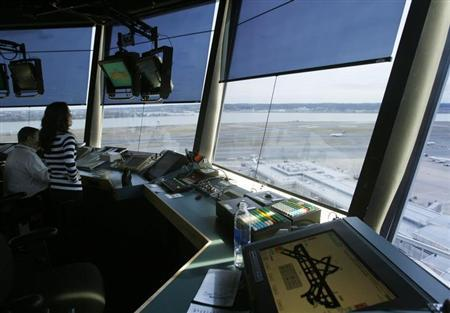 Reagan National Airport air traffic controller Sundie Yukich (2nd L) directs aircraft from the control tower in Washington February 28, 2013. REUTERS/Gary Cameron