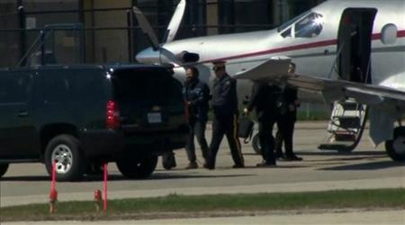 Canadian police escort suspect Chiheb Esseghaier from a plane to a truck after arriving in Markham, Ontario, April 22, 2013, in this still image taken from video courtesy of CTV News. REUTERS/CTV News/Handout