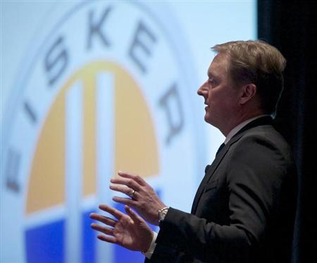Henrik Fisker, co-founder, executive chairman, and chief designer at Fisker Automotive speaks during the Chicago Auto Show, February 7, 2013. Fisker Automotive Inc, the ''green car'' company that has not produced a vehicle since July, expects to restart production of its Karma plug-in hybrid ''fairly soon,'' Fisker said on Thursday. REUTERS/John Gress