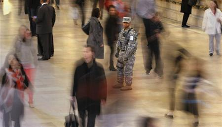 A member of the U.S. Army National Guard Joint Task Force Empire Shield stays vigilant as he stands guard at Grand Central Terminal in New York, April 16, 2013. REUTERS/Carlo Allegri