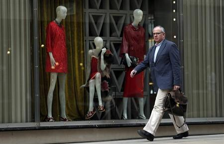 A man walks down New Bond Street in London April 19, 2013. REUTERS/Suzanne Plunkett