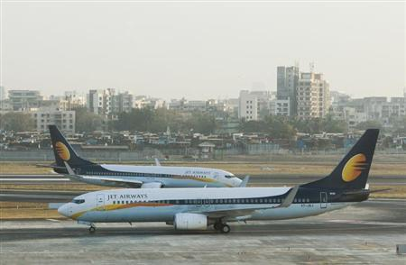 Jet Airways aircraft taxi on the tarmac at the domestic airport in Mumbai February 22, 2012. Picture taken on February 22, 2012. REUTERS/Vivek Prakash