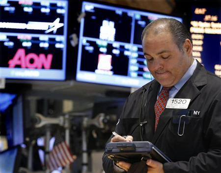 A trader works on the floor at the New York Stock Exchange, April 23, 2013. REUTERS/Brendan McDermid