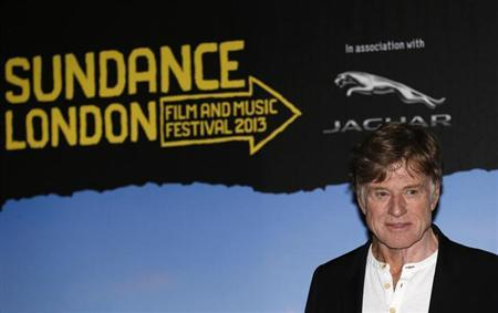 President and founder of the Sundance Institute, Robert Redford, poses for photographers during a news conference for Sundance London, at the O2 Arena in London April 24, 2013. REUTERS/Suzanne Plunkett