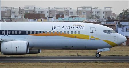 A Jet Airways passenger plane moves along the tarmac at the Sardar Vallabhbhai Patel international airport in Ahmedabad, April 24, 2013. REUTERS/Amit Dave
