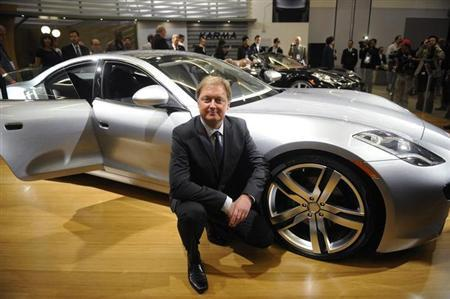 Henrik Fisker, Founder and CEO of Fisker Automotive, poses in front of the Fisker Karma following a news conference at the LA Auto show in Los Angeles December 3, 2009. REUTERS/Phil McCarten