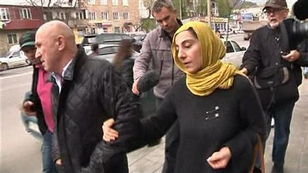 Journalists chase Zubeidat Tsarnaeva (R, front), mother of Boston bombing suspects Dzhokhar and Tamerlan Tsarnaev, in Makhachkala in this image from an April 23, 2013 video footage. To match Special Report USA-EXPLOSIONS/RADICALISATION REUTERS/Reuters TV