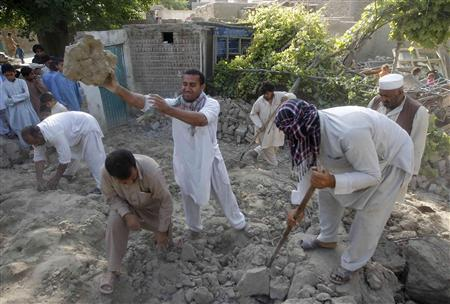 Earthquake survivors work on the rubble of a mud house after it collapsed following the quake in Jalalabad province, April 24, 2013. REUTERS/Parwiz