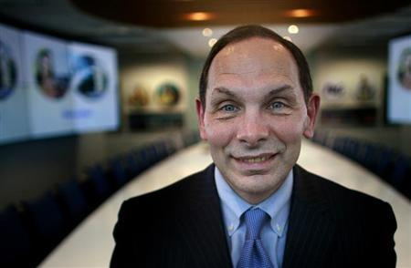 Procter & Gamble Chief Executive Robert McDonald poses at his company's office in Singapore February 25, 2013. REUTERS/Thomas White
