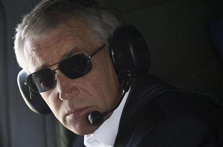 U.S. Defense Secretary Chuck Hagel looks out of the window during a helicopter tour of the Israeli-annexed Golan Heights April 22, 2013. REUTERS/Jim Watson/Pool - RTXYVUD