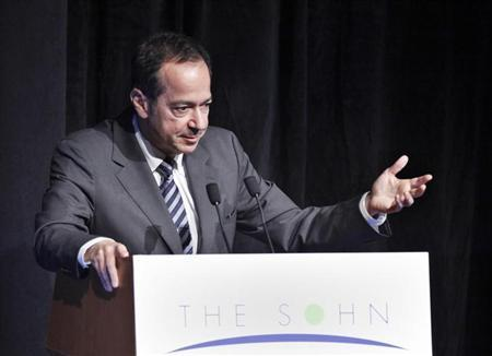 President and Portfolio Manager of Paulson & Co. John Paulson speaks during the Sohn Investment Conference in New York, May 16, 2012. REUTERS/Eduardo Munoz/Files