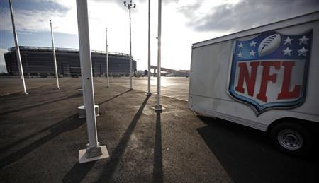 The NFL logo is seen on a trailer parked near the New Meadowlands Stadium where the New York Jets and New York Giants NFL football teams play home games in East Rutherford, New Jersey March 14, 2011. REUTERS/Mike Segar