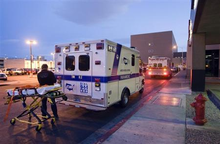 A member of an American Medical Response (AMR) ambulance crew prepares to put a gurney back into the ambulance after bringing a patient to University Medial Center in Las Vegas, Nevada, March 24, 2011. Emergency Medical Services Corporation is the parent company for both American Medical Response (AMR) and MedicWest. REUTERS/Steve Marcus
