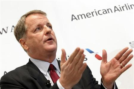 U.S. Airways CEO Doug Parker announces the planned merger of AMR Corp, the parent of American Airlines, with U.S. Airways during a news conference at Dallas-Ft Worth International Airport February 14, 2013. REUTERS/Mike Stone