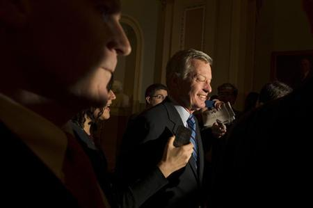 Sen. Max Baucus, (D-MT) is questioned by media at the U.S. Capitol in Washington December 31, 2012. REUTERS/Mary F. Calvert