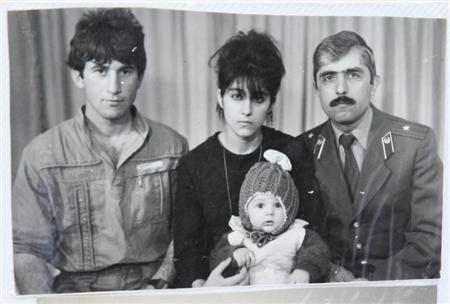 A photo, showing Tamerlan (C, bottom) Tsarnaev, accompanied by his father Anzor (L), mother Zubeidat and uncle Muhamad Suleimanov (R), is seen in this photo courtesy of the Suleimanova family in Makhachkala, April 22, 2013. REUTERS/Courtesy of Suleimanova family/Handout