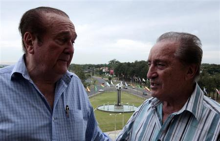 Nicolas Leoz, president of the South American Football Confederation, and his vice president Eugenio Figueredo, talk on a balcony two day before the opening of a soccer museum in Luque January 27, 2009. REUTERS/Jorge Adorno