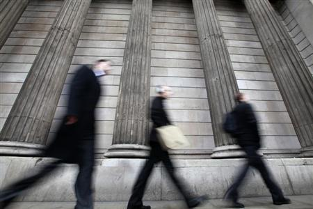 Pedestrians walk past the columns of the Bank of England, in the City of London February 15, 2011. REUTERS/Andrew Winning